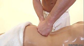 Oiled blonde babe fucks masseuses cock