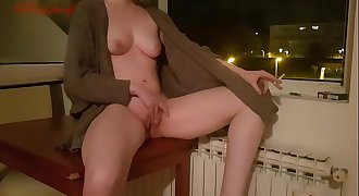 Horny redhead jilling at an open window and smoking