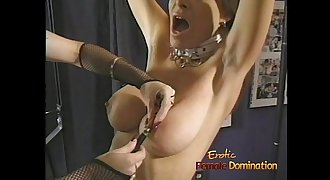 Beautiful brown-haired looker enjoys having some kinky BDSM fun with a redhead