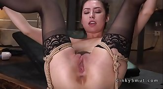 Busty victim tied up and banged in threesome